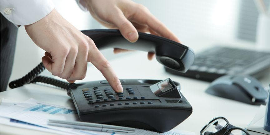 employee dialing on a business phone system