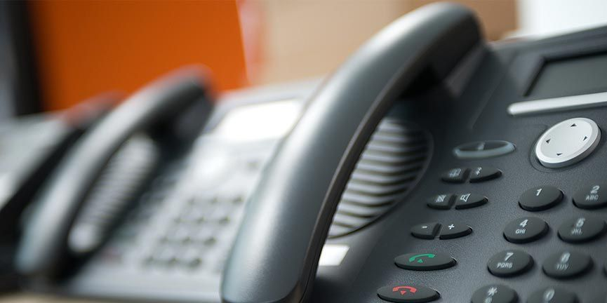 set of black voice over internet protocol phones