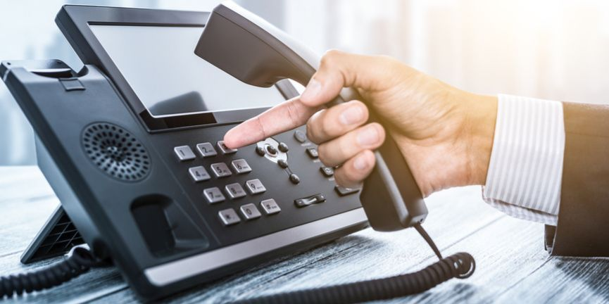 office worker dialing phone system