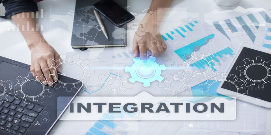 software integration icon on laptop, smartphone, and tablet