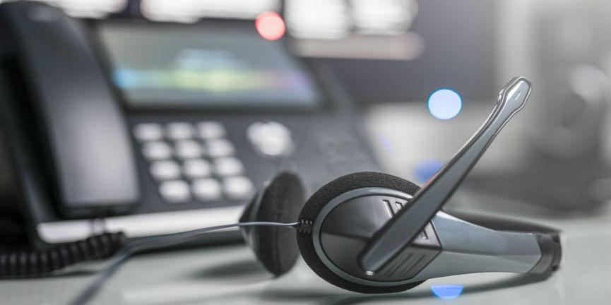 voip phone and headphone in office