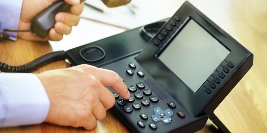 businessman using a voip phone