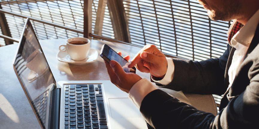 businessman using smartphone messaging
