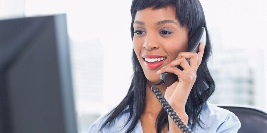 businesswoman answering office phone