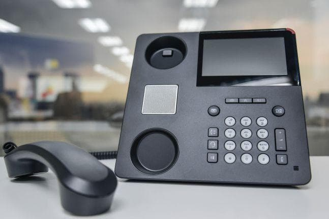 modern ip pbx phone on table