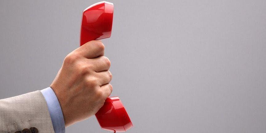 hand holding up telephone