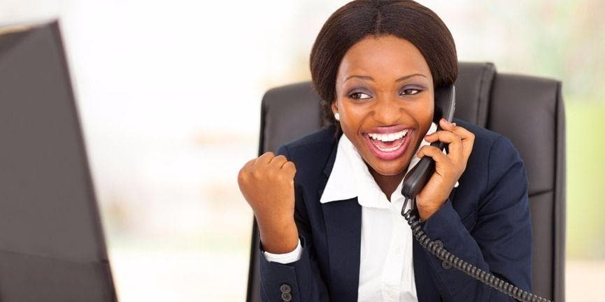excited business woman on the phone
