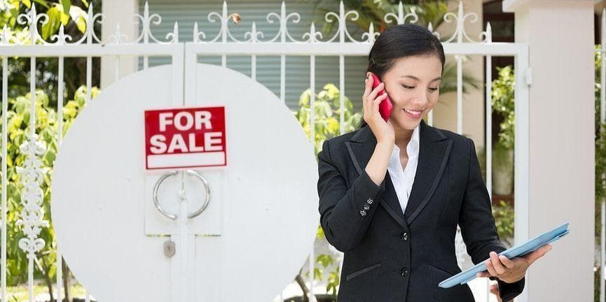 real estate agent calling with a smartphone