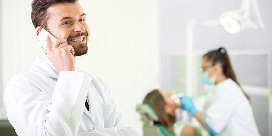 dental practitioner on the phone