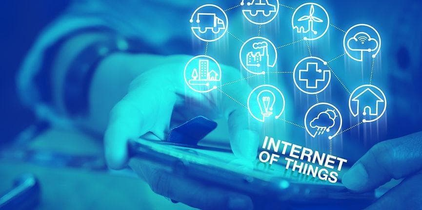employee holding mobile phone with Internet of things