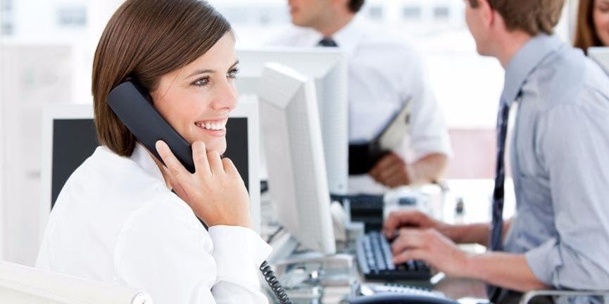 employee using office telephone