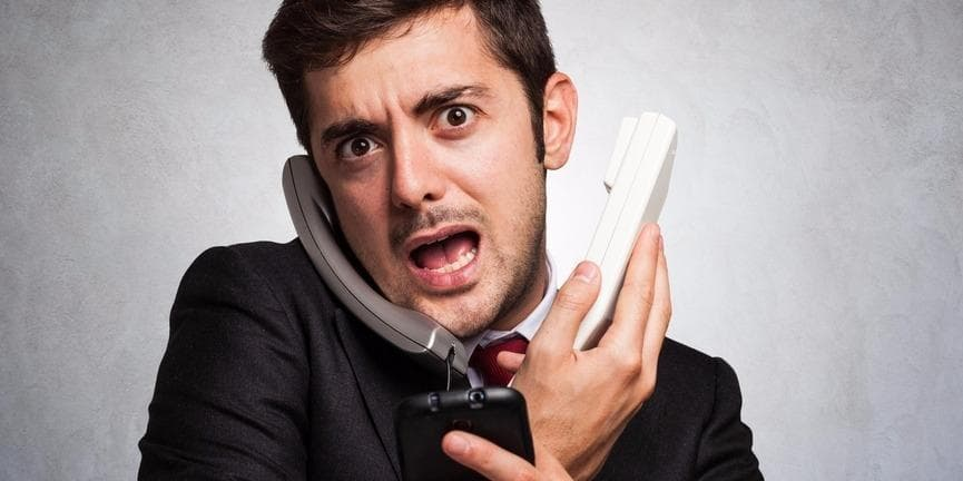 stressed employee answering calls