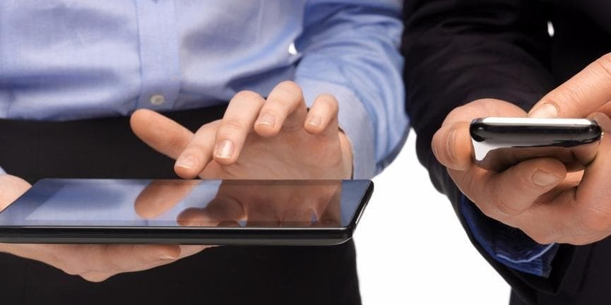 employees holding smartphone and tablet