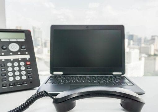 ip phone and laptop on desk