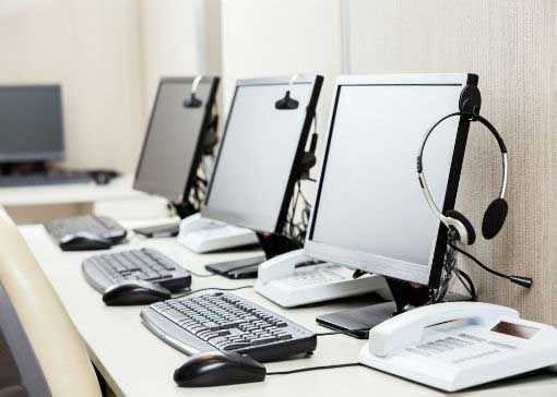 headsets, computers, and communication solutions in modern contact centers