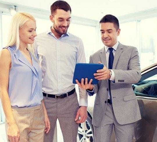 car salesman at car dealership