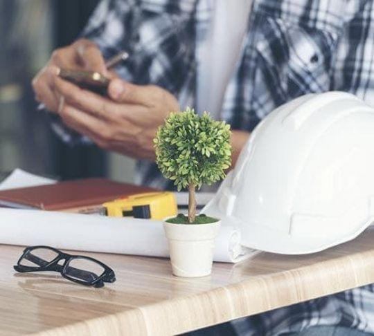contractor seated and using a mobile device