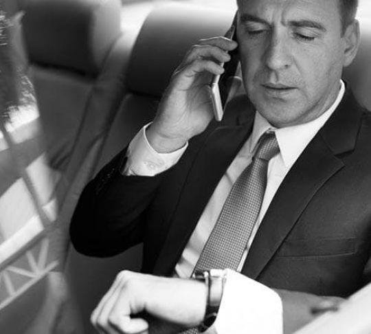 client in limo on mobile phone