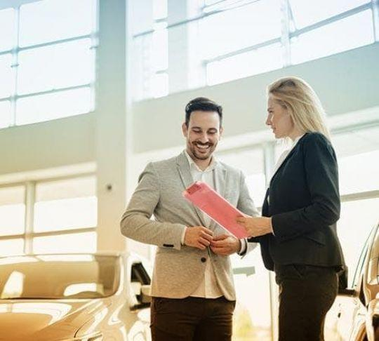 car salesperson discussing with customer