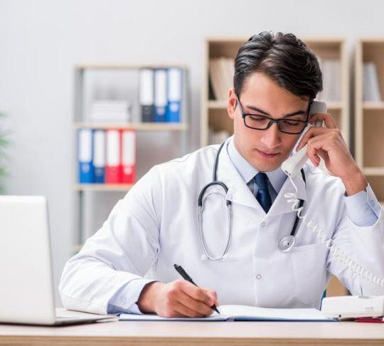 doctor calling patient on the phone