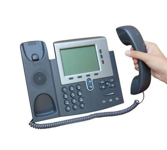 employee using ip phone for calling