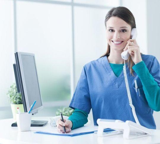 female nurse on phone at desk