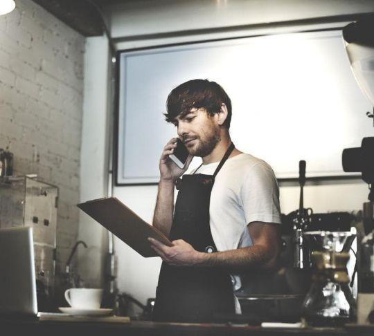 kitchen chef on phone