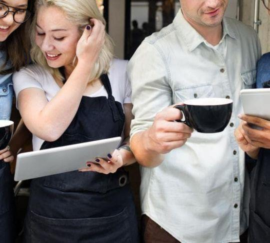 restaurant employees with phone and tablet