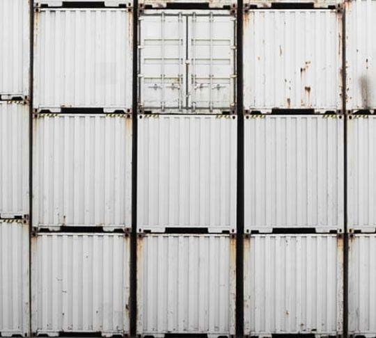 truck shipping containers stacked